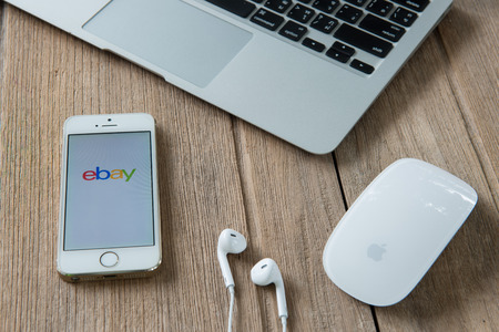ebay: CHIANGMAI, THAILAND - June 22, 2015:iPhone opened to Ebay homepage. Ebay, an online auction and shopping site, was founded in 1995.