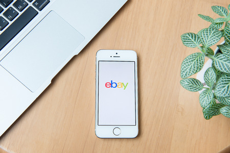 ebay: CHIANGMAI, THAILAND - June 24, 2015:iPhone opened to Ebay homepage. Ebay, an online auction and shopping site, was founded in 1995.
