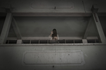 horror movie: Horror movie scene with a lonely figure on the hall,Horror Scene of a Scary Woman