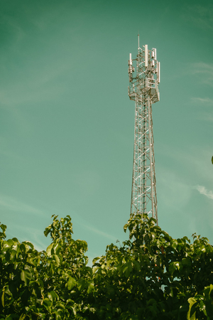 gsm: GSM cell transmission station and summer landscape with cloudy sky,Cellulartower,Telecommunications equipment Stock Photo