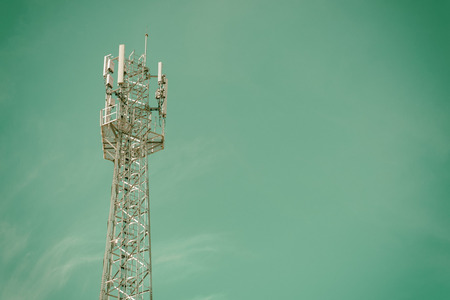 telecommunications equipment: GSM cell transmission station and summer landscape with cloudy sky,Cellulartower,Telecommunications equipment Stock Photo