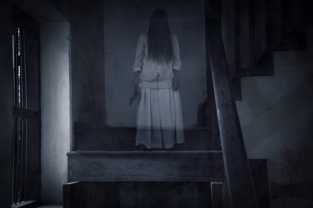 Horror movie scene with a lonely figure on the hall,Horror Scene of a Scary Woman