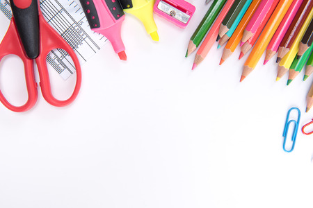 crayon  scissors: School supplies on white background ready for your design space.