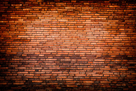 vignetted: brick weathered stained old brick wall background red brick wall texture grunge background with vignetted corners, may use to interior design Stock Photo