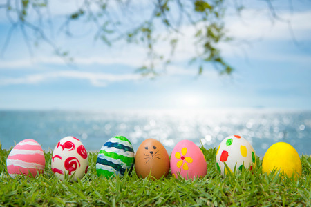 Easter Eggs Grass On the beach, the sea, beautiful summer morning. Stock Photo