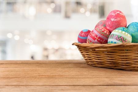 Colorful Easter egg side border against a rustic wood background