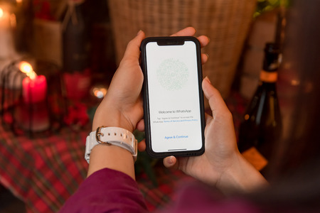 CHIANGMAI, THAILAND - JAN 16,2018:Brand new Apple iphone X with social Internet service WhatsApp on the screen. iPhoneX was created and developed by the Apple inc.