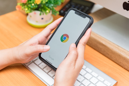 CHIANGMAI, THAILAND - JAN 07,2018 : close up on man hand hold iphone X for app googlechrome,iPhone X was created and developed by the Apple inc.
