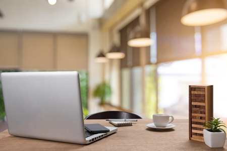 Workplace with notebook laptop Comfortable work table in coffee shop