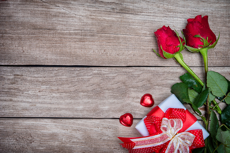 Valentines day background with rose and ribbon on wooden. Stock Photo - 104436403