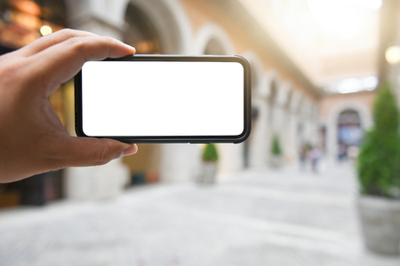 Man holding smart phone with blurred background. For Graphic display montage.with copy space.