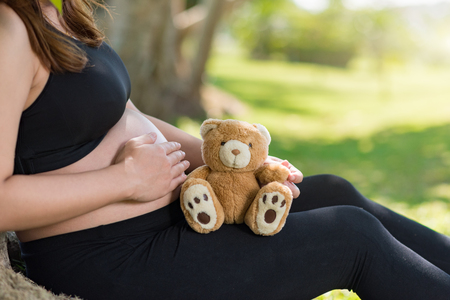 pregnant woman with teddy bear Stock Photo - 104435929