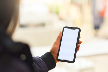 Hand is holding showing smartphone with blank mock up screen,This can be used to montage the mobile application. Stock Photo - 104435782