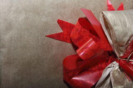 holiday shopping: Gift wrapped with red ribbon  Stock Photo