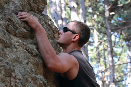 Beginner Boulder climber train of stones in pine forest Stock Photo - 8168726