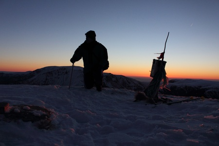 shivling: climber on Mount Kupena - 2169 m altitude in the Central Balkan Mountains in eastern Europe at sunrise