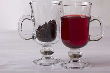 hibiscus flower tea, tea with flowers and red glass tea cup photo