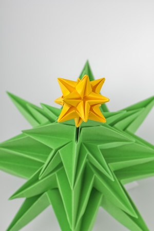 Origami - a Christmas green tree with star photo