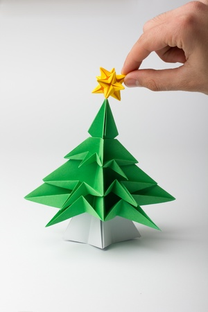 placing the poinsettia a little green tree - origami photo