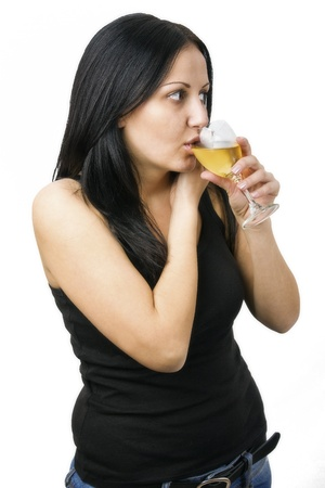 beautiful woman with glass white wine on white background photo