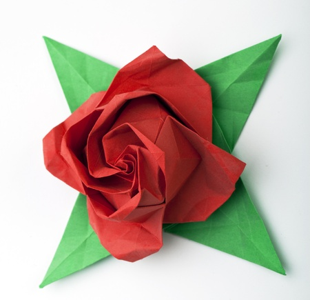 origami deg, red rose and green leaves photo