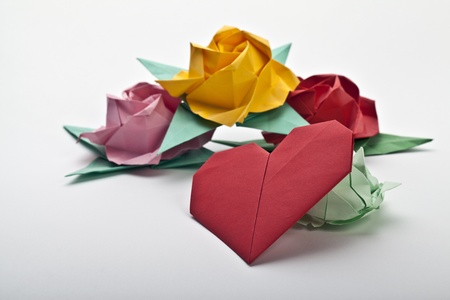 Origami a multi colored roses, green leaves and red heart photo