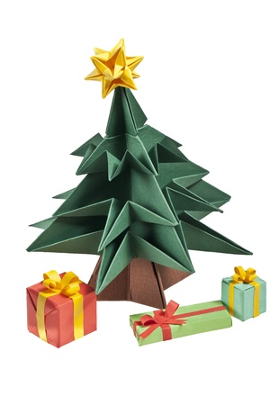An origami Christmas tree with a yellow star on its top and presents under it, isolated on a white background photo