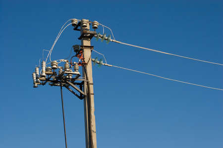 isolator insulator: concrete electric pole with wires and connectors