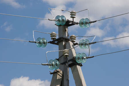 isolator insulator: concrete electric post with wires and connectors