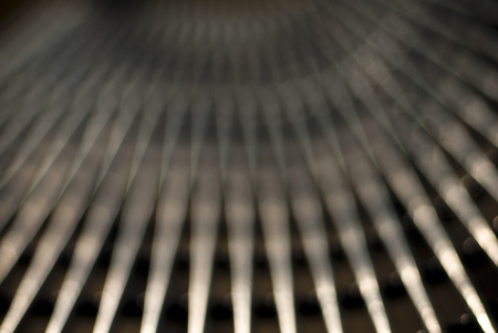 when: A metal park bench takes on a very different look when photographed out of focus and created a pattern of converging lines of light and dark.