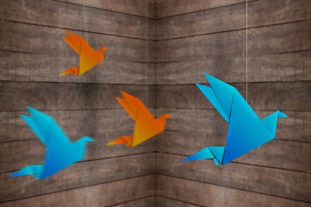 origami bird: origami bird with wooden background and motion blur effect