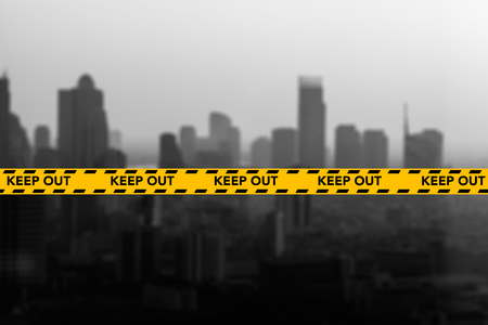 caution: Caution and danger ribbon strip tape with city out of focus Stock Photo