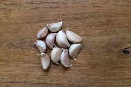 clove plant: Garlic on wooden background