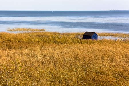 Little blue hut in water near Long Point Ontario