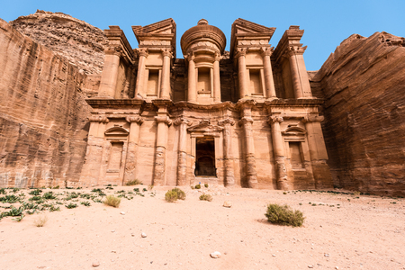 The stunning view of Ad Deir, the Monastery of Petra, Jordan on a clean blue sky winter day