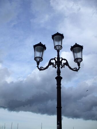 street lights on the background of the cloudy sky