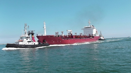 pilot accompanies a tanker in port