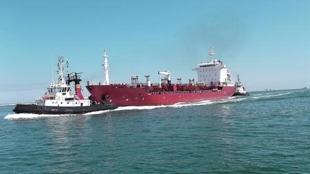 pilot accompanies a tanker in port