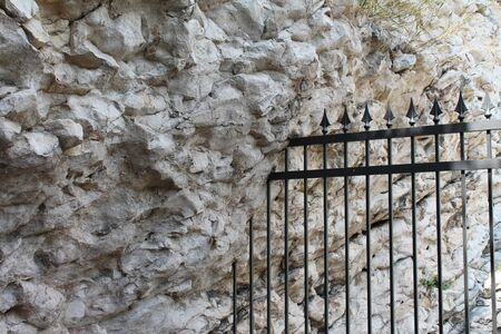 iron grille in the rock photo