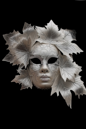 Venetian mask on black background photo