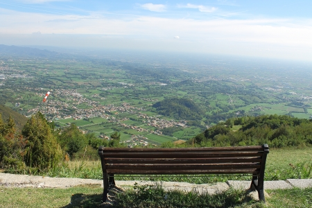 bench on top of a mountain panorama photo