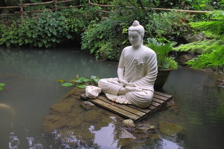 Buddha statue on the water Stock Photo