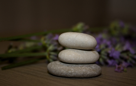 joga: Pyramid of three stones with reflect. Soft focus.