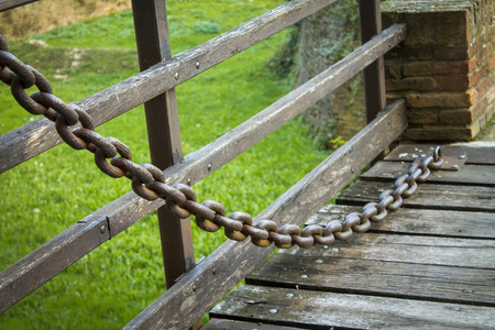 rusty nail: large iron chain on an old castle bridge