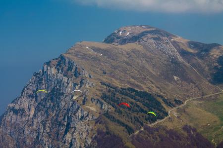 Wingsuit, Mount Baldo, Veneto Italy,Skydiver in flight against the backdrop of the mountain