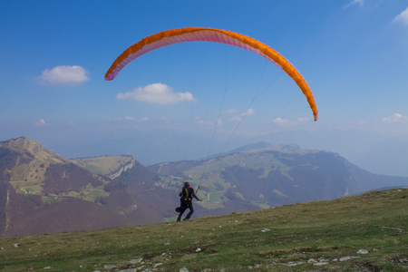 Skydiver in flight against the backdrop of the mountain