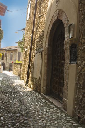 ancient wooden door, in the town of Molchesine, Italy