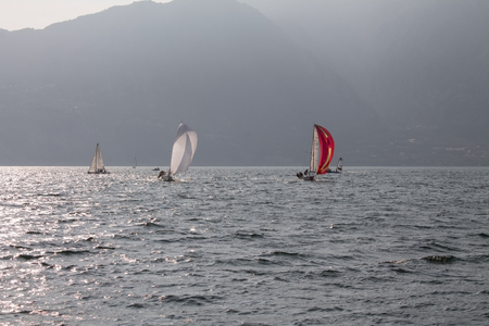 Sailing boat in the windy summerday on lake Garda Monselice Italy. Stock Photo