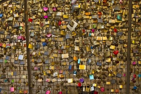 Love locks from a bridge in Italy representing secure friendship and romance