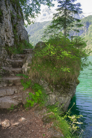 steps carved into the rock ,Tovel Lake, Trentino Italy.